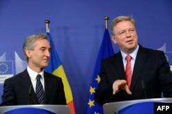 Moldovan Prime Minister Iurie Leanca (left) and EU Enlargement Commissioner Stefan Fuele speak to reporters in Brussels on June 14.