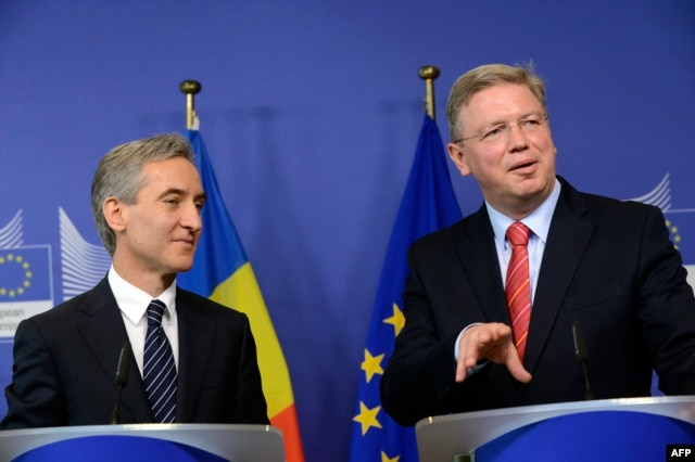 Moldovan Prime Minister Iurie Leanca (left) and EU Enlargement Commissioner Stefan Fuele speak to reporters in Brussels on June 14.
