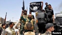 قوات عراقية تسيطر على موقع لداعش وتنزل علمها
