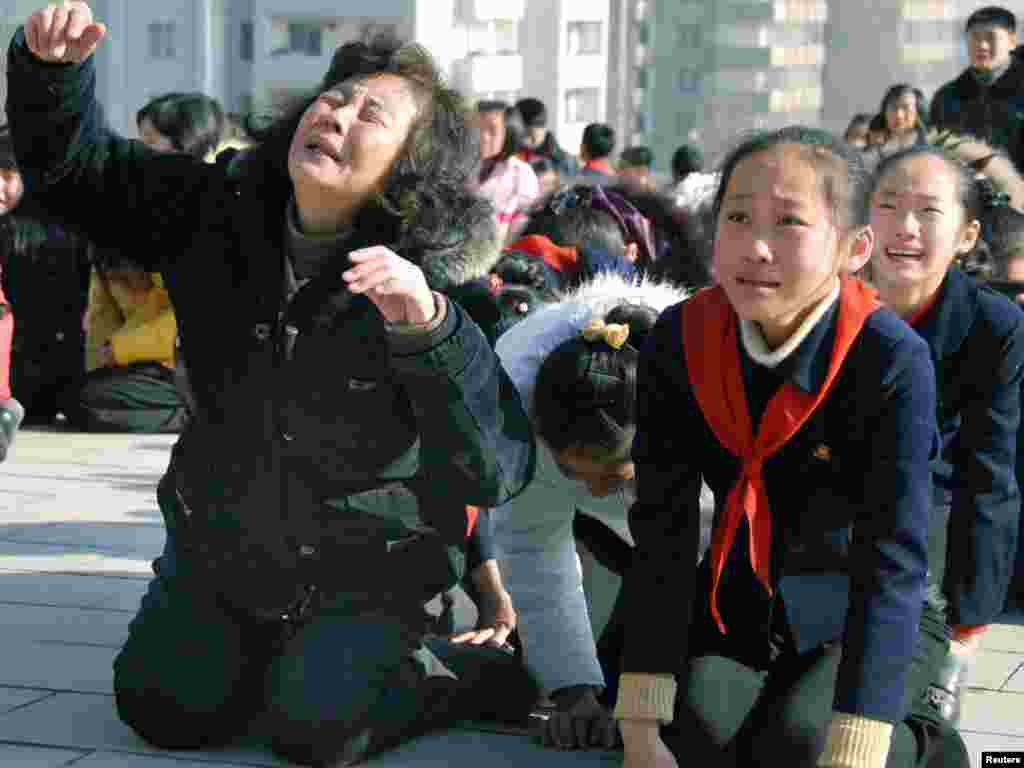 North Koreans react as they mourn Kim's death in Pyongyang on December 19.