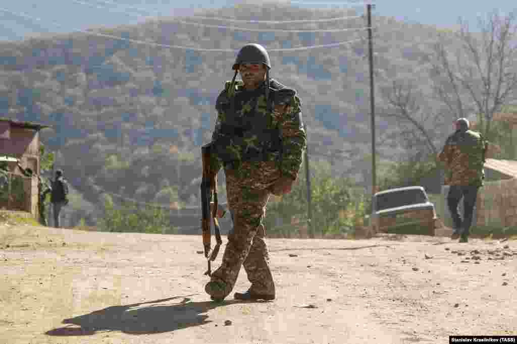 A militiaman walks on an empty road in Avetarnots, 14 kilometers from Stepanakert, the largest city in Nagorno-Karabakh.