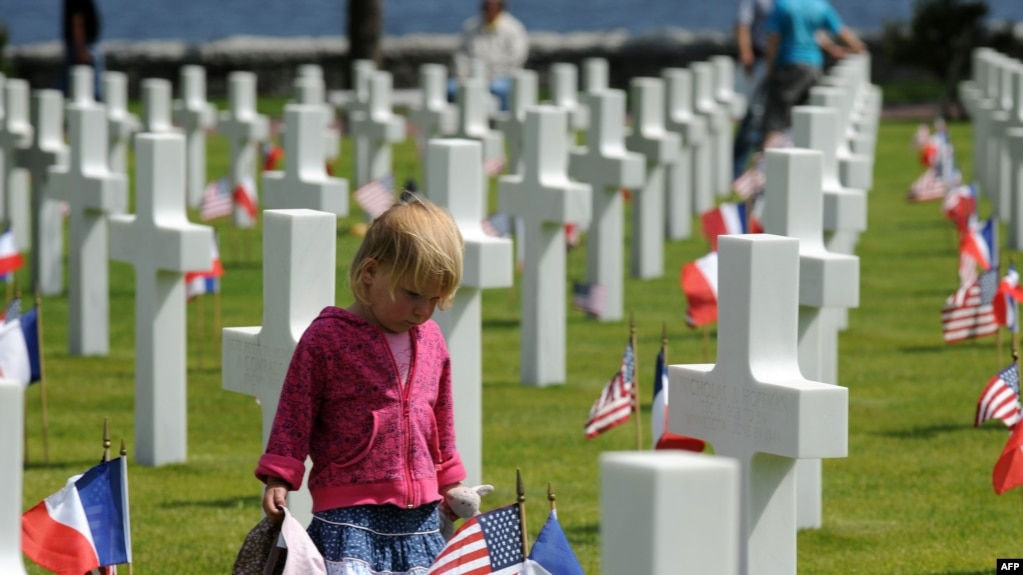 A Young Girl At The American Cemetery In Colleville Sur Mer Near Omaha