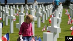 A young girl at the American cemetery in Colleville-sur-Mer, near Omaha Beach, ahead of the June 6 ceremonies.