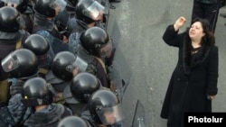 A woman confronts rows of riot police in downtown Yerevan on March 1, 2008.