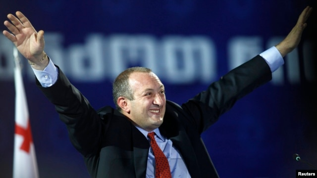 Giorgi Margvelashvili, the presidential candidate of the ruling Georgian Dream coalition, waves to supporters during a presentation of his election program in Tbilisi on September 19.