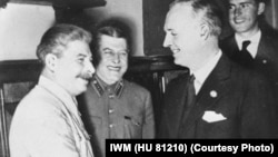 According to Vladimir Putin, Soviet leader Josef Stalin (left, with German Foreign Minister Joachim von Ribbentrop at the pact's signing) had no choice but to agree to divide up Eastern Europe in a secret pact with Nazi leader Adolf Hitler.