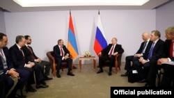 Russian - Russian President Vladimir Putin and Armenian Prime Minister Nikol Pashinian meet in Sochi, 14 May 2018.