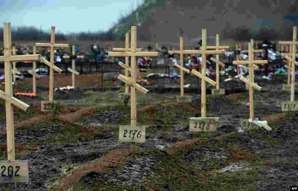 Crosses marked only with numbers stand on the graves of unknown pro-Russian separatists at a cemetery in the eastern Ukrainian city of Donetsk. (AFP/Vasily Maximov)