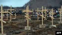 Crosses marked only with numbers stand on the graves of unknown pro-Russian separatists at a cemetery in the eastern Ukrainian city of Donetsk in February.