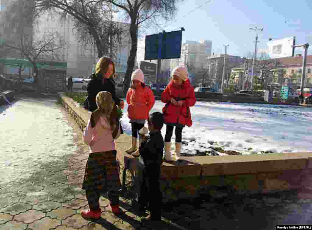 Luli children gather on a corner in Bishkek to beg for spare change.