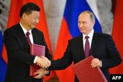 Владимир Путин и Си Цзиньпин в Кремле. 4 июля
