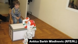 Four-year old Croatian boy Luka (left), who has autism spectrum has developed an unusual friendship with a robot called Rene.