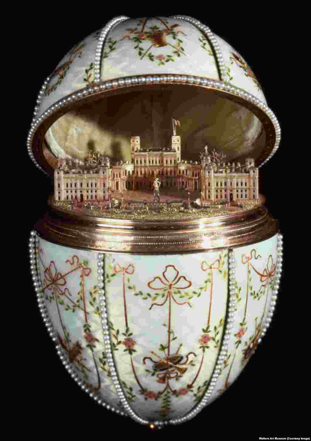 "The tsar's one request for the eggs was that they contain some kind of ""surprise."" In the case of the Gatchina Palace Egg, the egg opened to a gold replica of the royal residence in the countryside of St. Petersburg. The 8-centimeter building is precise down to the hedges, gravel courtyard, and fluttering flag of the real palace."
