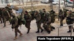 Kazakh Interior Ministry troops patrol in Aqtau, the regional capital of the western region, on December 21.