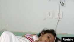A survivor of a bomb blast in her hospital bed in Mahabad on September 22