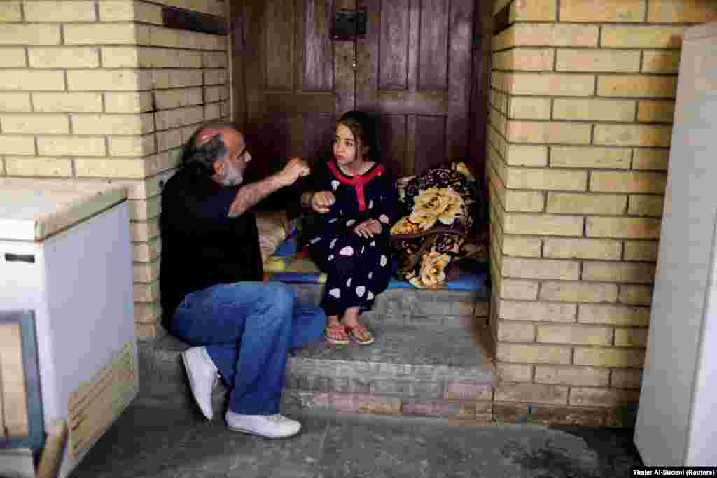 IRAQ - Director Hassan Husni speaks to an Iraqi girl actor to prepare for a scene of the hotel TV series, which is being filmed and broadcast during the Muslim holy month of Ramadan, in Baghdad, Iraq May 12, 2019