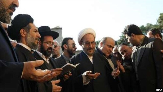 Iranian officials and members of the Jewish community pray together at a ceremony to unveil a monument honoring Iranian-Jewish soldiers who died in action during the Iran-Iraq War of the 1980s.