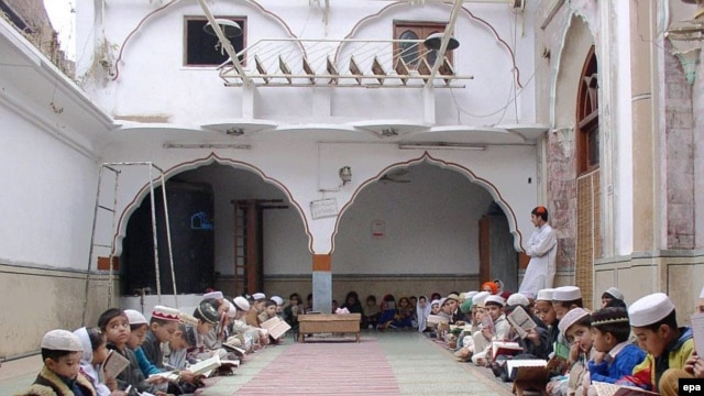 Madrasah students study at a mosque in Peshawar, Pakistan.