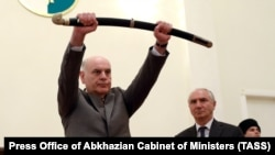 Aslan Bzhania holds a sword during his inauguration ceremony in Sukhumi on April 23.