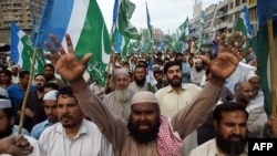 Supporters of Pakistan's Islamist party Jamaat-e-Islami shout slogans during a protest against the execution of convicted murderer Mumtaz Qadri in Karachi in March 2016.