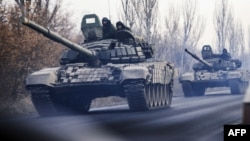 A column of tanks is photographed driving in rebel-held territory near Donetsk in eastern Ukraine.