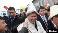 Kyrgyzstan's President-elect Almazbek Atambaev (centre) on the campaign trail last month.