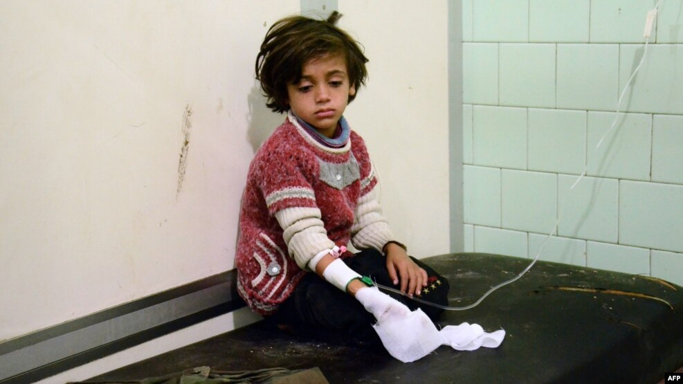 An injured child waits after receiving treatment at a hospital in a government-held neighborhood in the northern city of Aleppo on November 3.