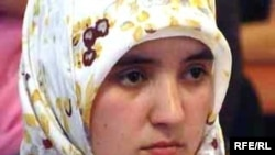 A young woman wears a hijab in Tajikistan.