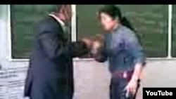 A student purported to be the daughter of an Uzbek prosecutor beats and humiliates a teacher at a university in Uzbekistan.