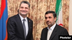 Armenia - Prime Minister Tigran Sarkisian (L) meets with Iran's visiting President Mahmud Ahmadinejad, 23Dec2011.