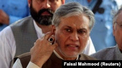 Pakistani Finance Minister Ishaq Dar is seen after a party meeting in Islamabad on September 26.