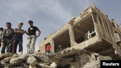 در روز انتخاباتی بغداد تنها ۳۲ نفر در اثر یک بمبگذاری که به فرو ریختن دو ساختمان انجامید، حادثه دیدند