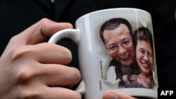 A mug bearing a picture of mainland jailed dissident Liu Xiaobao and his wife Liu Xia, who is currently under house arrest.