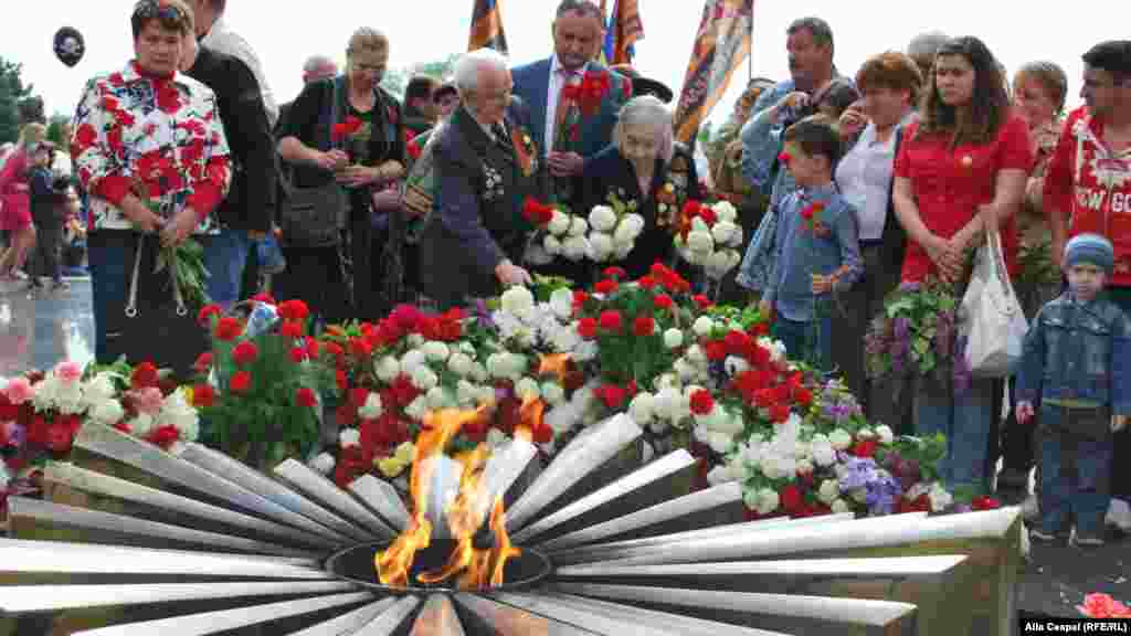 Veterans and relatives commemorate Victory Day in Chisinau, Moldova.