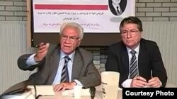 الباحث كاظم حبيب (يسار) يتحدث في لقاء مع الجالية العراقية بهولندا والى جانبه نهاد القاضي
