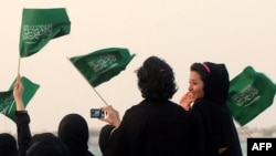 Women cheer and wave national flags in Jeddah, Saudi Arabia. (file photo)