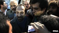 Director Asghar Farhadi (center) was mobbed by fans on his arrival at Tehran's airport in early March, two weeks after his Oscar victory.