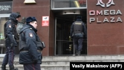 Russian police officers gather at the entrance to a business center that houses an FBK office in Moscow during a previous round of searches.
