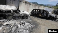 Burned-out Kosovo police vehicles at the Serbia-Kosovo border crossing in Jarinje following violent ethnic clashes in July.