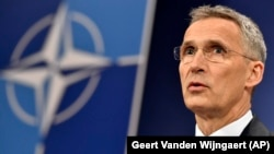 NATO Secretary-General Jens Stoltenberg speaks to the press at NATO headquarters in Brussels on April 26.