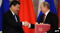 Встреча президента России Владимира Путина с китайским коллегой Си Цзиньпином в Кремле. Москва, 22 марта 2013 года.