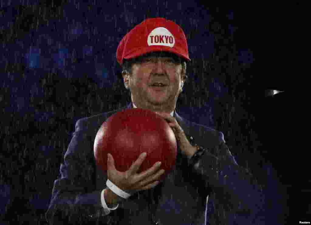 Japanese Prime Minister Shinzo Abe dressed as Nintendo's Super Mario onstage at the closing ceremonies of the Rio Olympics.