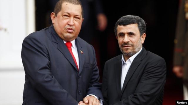 Hugo Chavez (left) with Iranian President Ahmadinejad in Caracas in January, 2012.