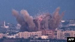 Израильдің оңтүстігіндегі Сдерот қаласында зымыран түскен аумақ. 15 қараша 2012 жыл.