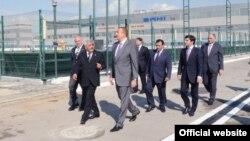 Президент Азербайджана Ильхам Алиев, президент ГНКАР Ровнаг Абдуллаев, сын министра транспорта Зии Мамедова Анар Мамедов, владелец группы компаний Baghlan Group Хафиз Мамедов