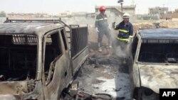 Pamje pas një sulmi të mëparshëm me bombë afër një xhamie shiite në Bagdad