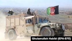Afghan troops patrol during an operation against IS militants in Nangarhar.