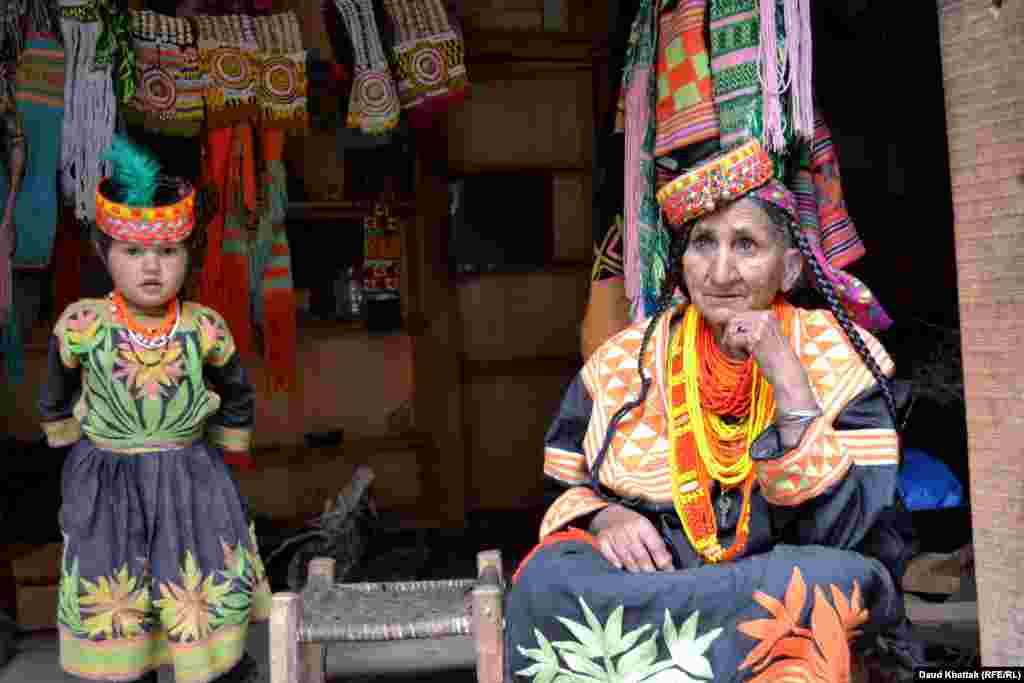 A woman selling Kalash clothing. After slowly declining in numbers, recent years have shown a slight increase in the population of the Kalash to around 4,000, but their culture faces pressure from many fronts.
