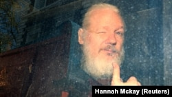 WikiLeaks founder Julian Assange arrives at a London court earlier this year.
