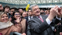 Ukrainian President Petro Poroshenko takes selfies with supporters at Olimpiyskyi Stadium in Kyiv on April 14.